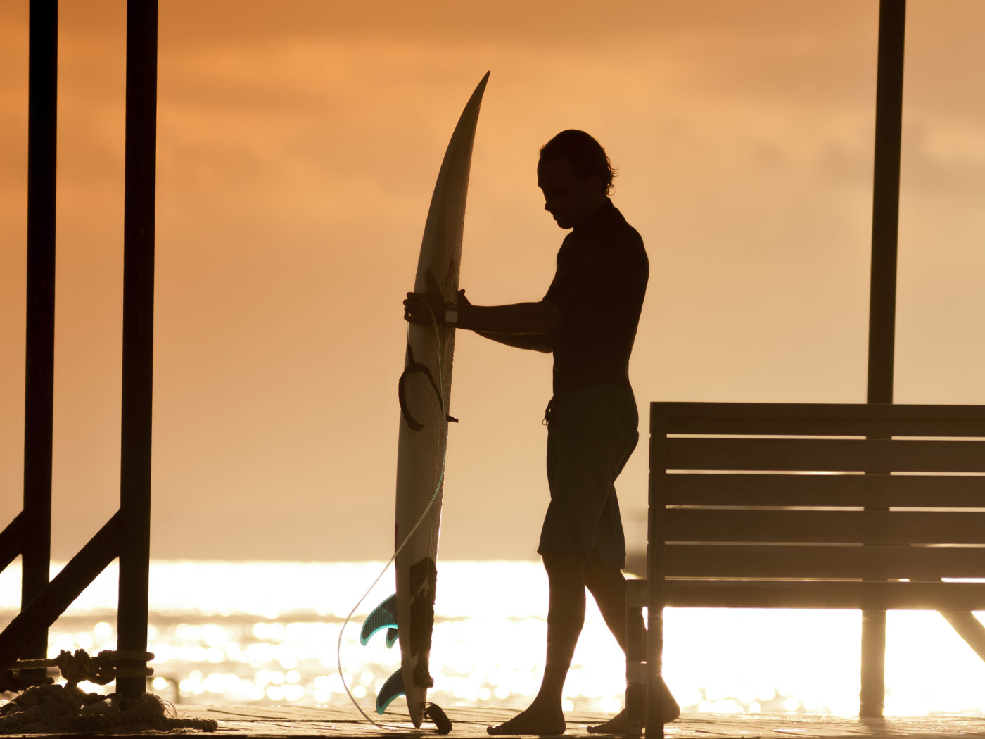 Surfer  with a surfboard at Sunset Tme, Bali, Indonesia released